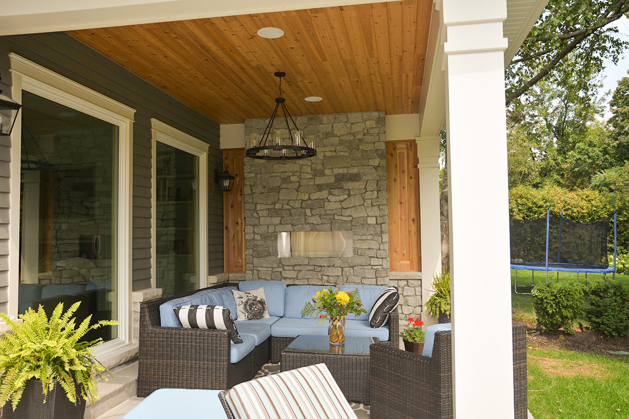 Outdoor custom stone fireplace design in Oakville by professional builder